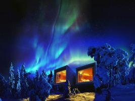 zdroj EIA/Slov Inn Jasná Tree Houses/ Popisek: Polární záře nad stromovou chatkou